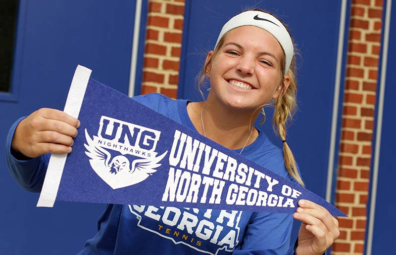 Girl holding UNG pennant