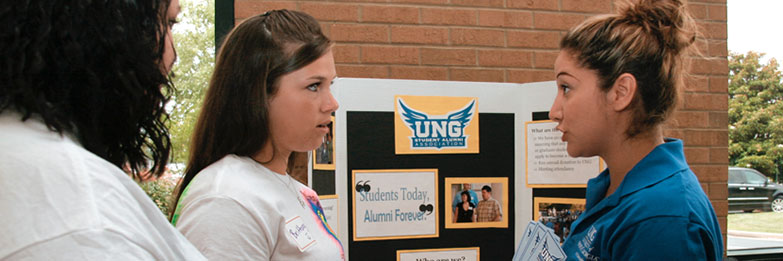 UNG representative talking to a high school student