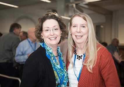 two alumna at an alumni event