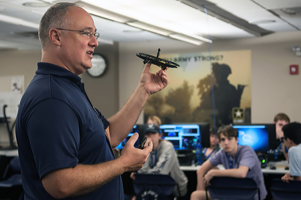 Dr. Bryson Payne, director of the Center for Cyber Operations Education at UNG's Dahlonega Campus, explains how to control a drone with an app from a cell phone to the Cyber Warriors class.