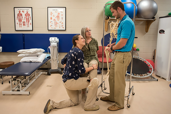 Doctor of Physical Therapy students Alex Sexton (right) and Matt Connor talk with a patient at the UNG Student-led Therapy and Rehab (STAR) clinic.