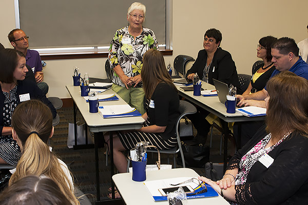 Tricia Bunker, director of donor relations and stewardship in the UNG University Advancement office, introduces herself to other Ed.D students during the group's orientation session Aug. 18.