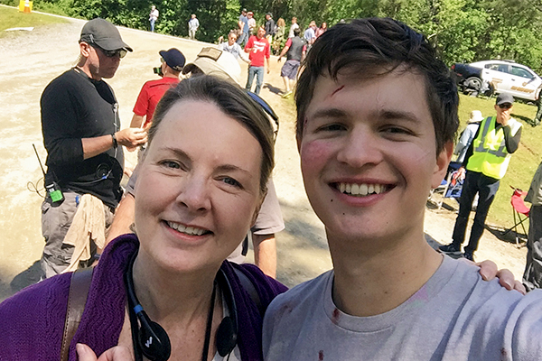 Elisa Carlson with lead actor Ansel Elgort on the set of the movie Baby Driver.