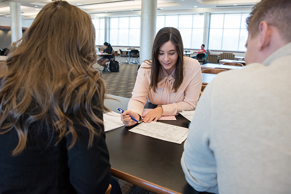 Ashley Short, a senior accounting and finance major, talks to fellow students about the VITA program and the advantages it offers.