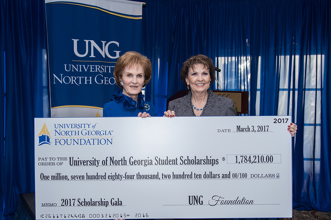 Mary Helen McGruder, chair of the UNG Foundation, left, presents a check representing the amount of scholarships awarded to students during the 2016 fiscal year to UNG President Bonita Jacobs.