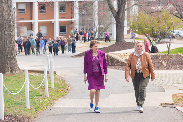 UNG President Bonita Jacobs (left) leads the Kick-off Walk along with Beth Arbuthnot (right) on UNG's Dahlonega Campus.