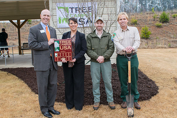 UNG Cumming Campus Executive Director Jason Pruitt, Dr. Alison Bailey and representatives from the Georgia Forestry Commission celebrate UNG's Tree Campus USA designation with a tree planting ceremony.