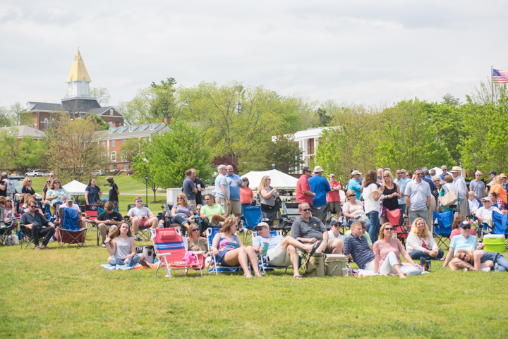 Alumni and their families gather on the grass near the promenade on UNG's Dahlonega Campus for the live music and family fun event held during Alumni Weekend.