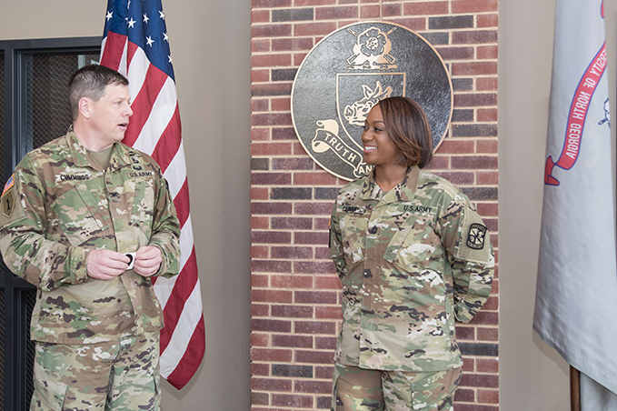 Sgt. 1st Class Shannon Clark is congratulated by Col. Brent Cummings, UNG's professor of military science, prior to receiving her new instructor badge. Clark is the first ROTC instructor in the nation to earn the badge.