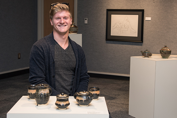 Art education major Dustin Hogan exhibits three pieces of his work at the Roy C. Moore Art Gallery at UNG Gainesville.