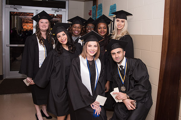 Students celebrate with group photos just prior to graduation at UNG's fall 2016 commencement ceremonies on the Gainesville Campus.