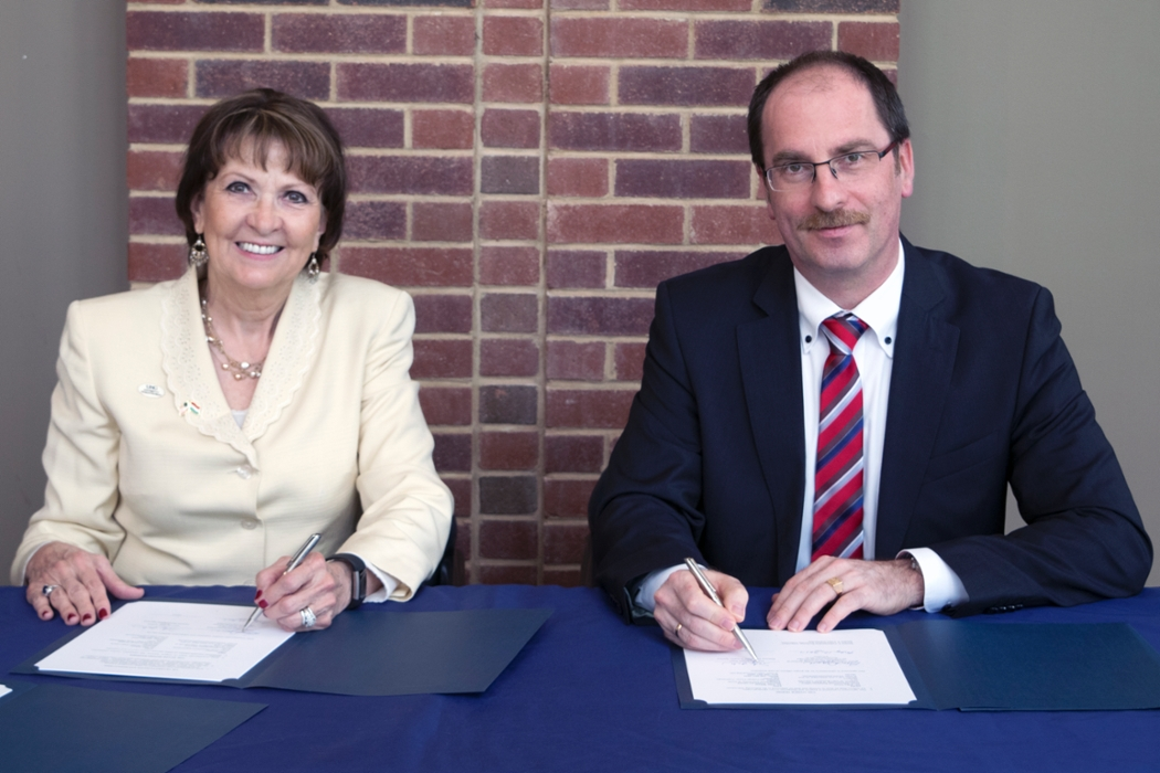 UNG President Bonita Jacobs, left, and NUPS President Andras Patyi, sign agreements between the two universities in a ceremony held May 12 on UNG's Dahlonega Campus. Administrators and faculty members from both universities were on-hand for the event.