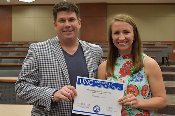 Jonathan Clapp, husband of the late Allison Clapp, presents UNG nursing student Whitley Dyer with the first Allison Clapp Memorial Scholarship.