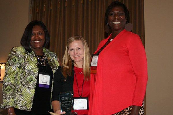 DeEnna Walters (center) was awarded the NACAS South Regional Rising Star award by NACAS membership coordinator Felecia Townsend (left) and Rebecca Brown (right), chair of the evaluation committee.