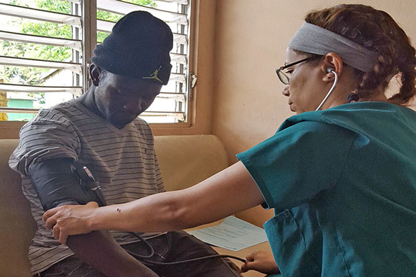 University of North Georgia nursing students treated more than 1,100 patients during a medical mission trip in May to the Dominican Republic. UNG nursing nursing student Majdouline Monroe takes a man's blood pressure at one of the mobile clinics.