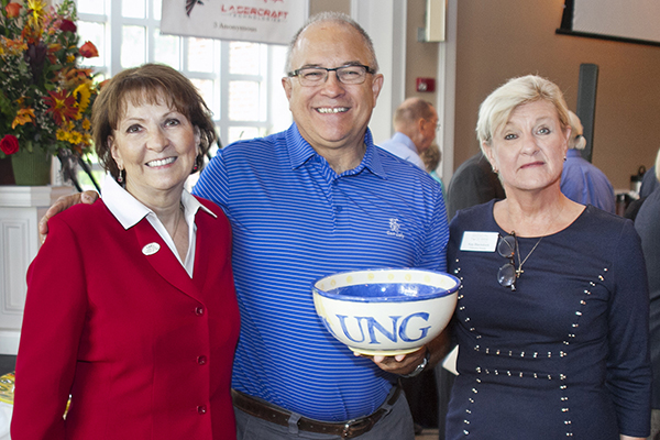 Dr. Bonita Jacobs, president of the University of North Georgia (UNG), is pictured with Tony Hernden and Kay Blackstock, executive director of Georgia Mountain Food Bank (GMFB), during the annual Empty Bowl Lunch at First Baptist Church in Gainesville. Hernden bid and won the UNG bowl during the auction, which  raises money for the food bank.