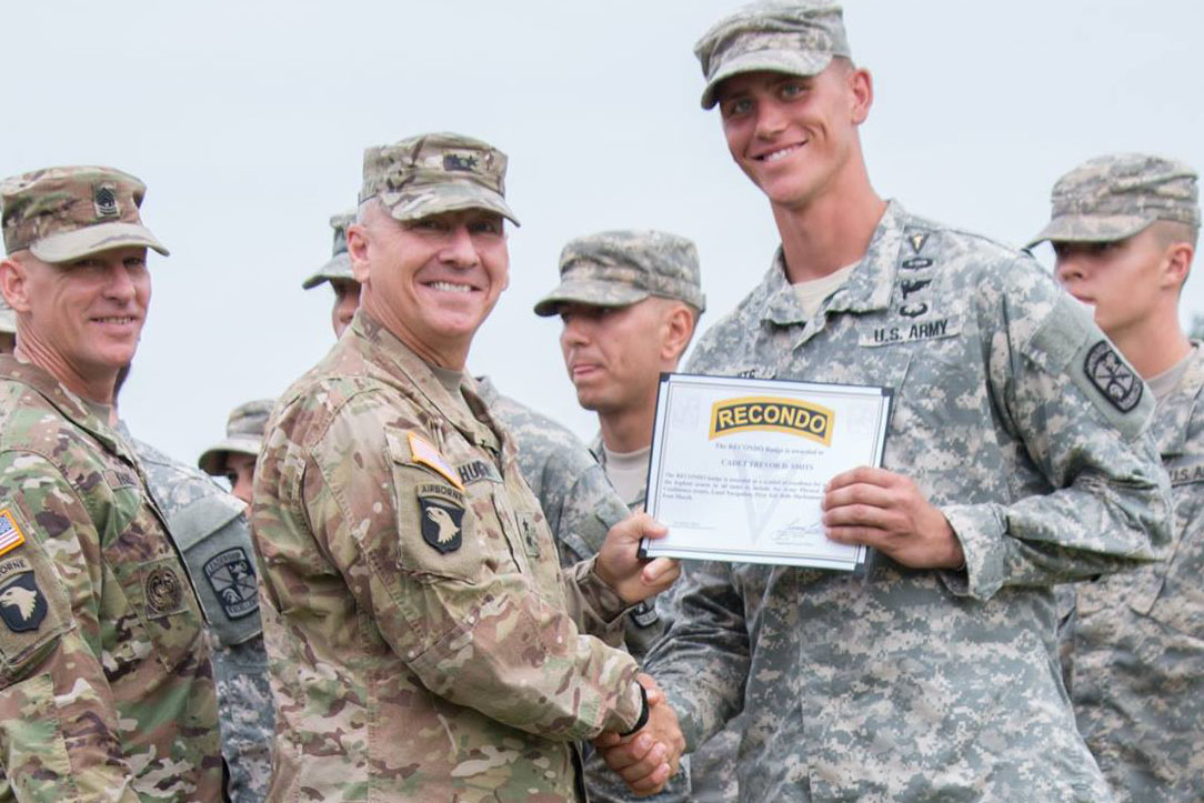 Trevor Smits is congratulated for receiving the Recondo Badge by Maj. Gen. Hughes, commander of U.S. Army Cadet Command and Fort Knox, at the 6th Regiment Advanced Camp graduation on July 10 at Fort Knox, Kentucky.