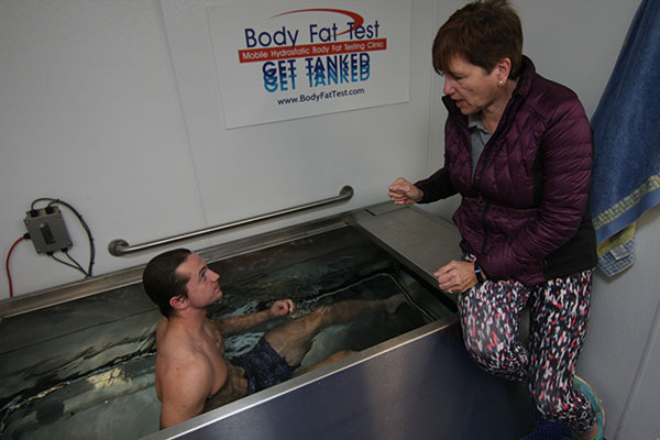 Ewan Bain, a 21-year-old senior from Ayr, Scotland, takes advantage of the mobile hydrostatic body fat test in October 2017 on University of North Georgia's Dahlonega Campus. After dunking himself in the tank, Bain received a breakdown of his body fat along with a detailed analysis of his BMI percentages. Delivering the results was UNG alumna Lynn Sweatte. She co-owns Body Fat Test Company with her husband, Chip Sweatte.