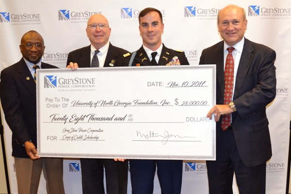 On Nov. 10, representatives of GreyStone Power Corp. presented a check for $28,000 to Phil Collins, development officer for the Corps of Cadets at UNG. From left: Milton Jones, veteran and chairman of GreyStone's Board of Directors; Collins; Capt. Elijah Carroll, an alumnus and instructor in UNG's Department of Military Science; and Gary Miller, UNG alumnus and GreyStone president and CEO.