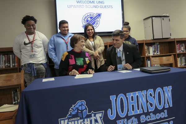 University of North Georgia (UNG) President Bonita Jacobs and Hall County Schools Superintendent Will Schofield officially sign on as participants in the Upward Bound program at Johnson High School in Gainesville, Georgia. The federal government awarded the University of North Georgia (UNG) $2.6 million to help promising low-income, first-generation high school students from Johnson High in Gainesville, Georgia, and Gilmer High in Ellijay, Georgia, prepare for and be successful in college.