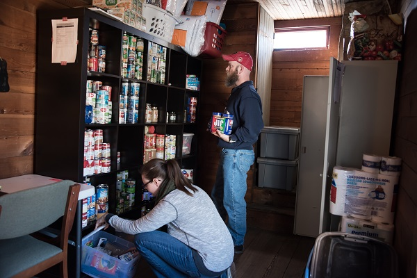 Students Chris Cato and Harlie McCurley volunteer in a new food pantry on the UNG Dahlonega Campus.