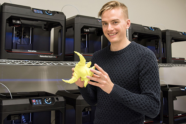 Connor Shields, a senior art marketing major, produces a model using the 3D equipment in UNG's new MakerBot Innovation Center.