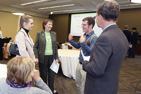 : UNG students McKenna Rogness, left, and Kalub Anderson talk with President Bonita Jacobs after a practice presentation session for the monthly meeting of USG Board of Regents.