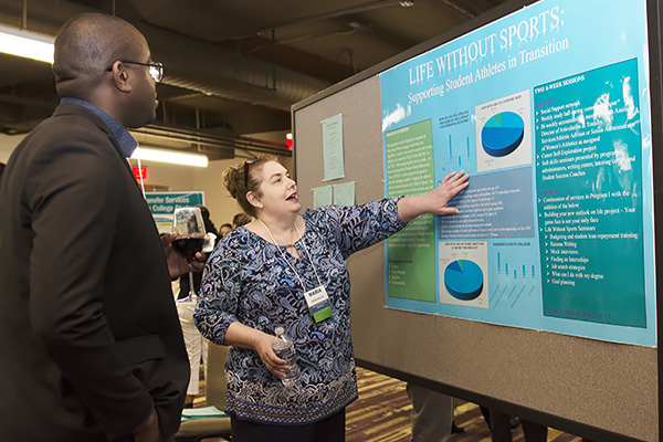 "Maria Miller, assistant director of articulation and transfer resources at Our Lady of the Lake University in San Antonio, Texas, talks about her poster presentation; ""Life Without Sports: Supporting Student Athletes in Transition,"" at the NISTS Conference in Atlanta."