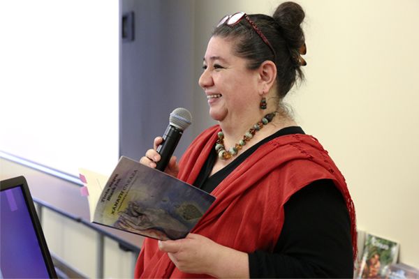 "Latino poet and educator Xánath Caraza reads from ""Black Ink,"" a book of her poetry during her visit to UNG as part of National Women's History Month on March 6-7."