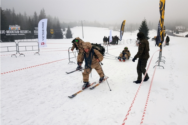 "UNG cadets Will Walters, Garrett Wilson and Dallas Yeargin created an improvised tobaggon to ""evacuate"" a teammate during a portion of the 36-hour Military Ski Patrol competition in Poland."