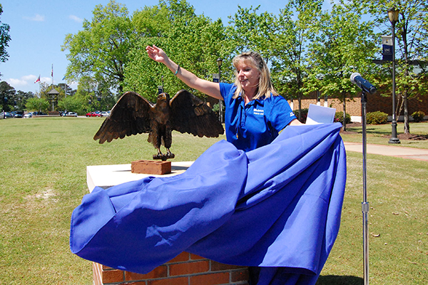 University of North Georgia (UNG) senior Michelle McAdams unveils a Nighthawk statue to physically and symbolically link four UNG campuses with one single tradition. McAdams, the outgoing Student Government Association president, revealed the statue April 27 on UNG's Gainesville Campus. An identical Nighthawk statue was unveiled on the Dahlonega Campus. Two more statues will be installed on the Cumming and Oconee campuses at a later date.