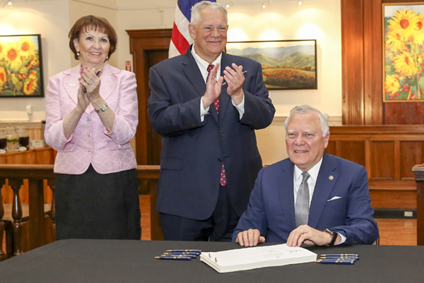University of North Georgia President Bonita Jacobs, left, and Georgia Speaker of the House David Ralston, center, applaud as Georgia Gov. Nathan Deal signed the state budget May 2 at the Blue Ridge Mountains Art Association Center in downtown Blue Ridge. The budget includes funding for UNG campus expansions in Blue Ridge and Dahlonega.