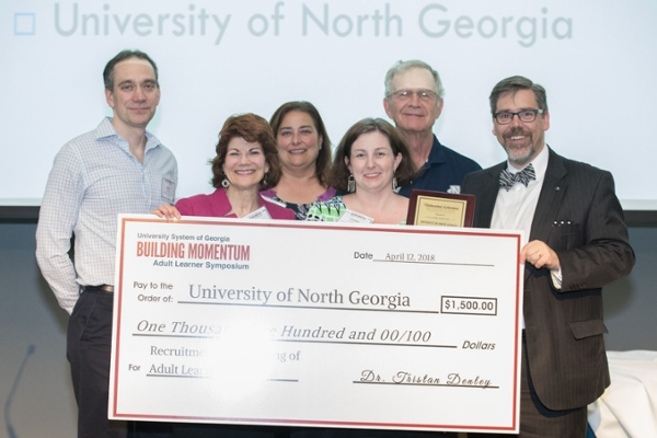 Members of UNG faculty and staff pose with Dr. Tristan Denley, chief academic officer of the University System of Georgia (USG), with the USG Adult Learner Recruitment Award.