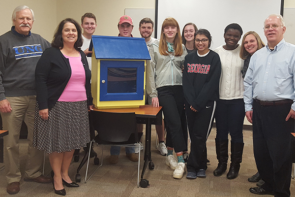 Members of the University of North Georgia's Oconee Campus Habitat for Humanity Club built a Little Free Library for the city of Watkinsville. Pictured in front of the Little Free Library are, from left, Randall Parish, Dr. Cyndee Perdue Moore, Emery Peavy, Matthew Beelman, Cameron McKelvey, Anne Whatley, Ashley Watson, Gicel Sagastume, Maria Anifowose, Susan Brantley, and Phil Branyon.