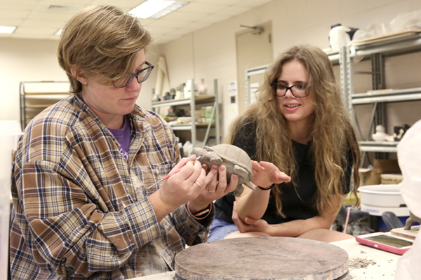 UNG senior Kati Hornick works on a sculpture of a turtle for the Faculty Undergraduate Summer Engagement (FUSE) project with Heather Foster, limited term faculty of visual arts at UNG. Hornick and Foster were inspired by the eastern box turtle research conducted by Dr. Jennifer Mook and Dr. Natalie Hyslop, associate professors of biology at UNG.