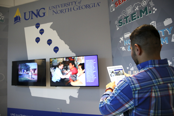UNG's Career Exploration Center will welcome students with its interactive board at the center's entrance. Using an iPad or a computer tablet, students will hold the device over a picture and a person with connections to UNG appears on the screen to talk about a specific career pathway such as nursing, business or one of 15 others.