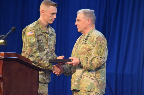 Cadet Col. Tyler Farney, commander of UNG's Boar's Head Brigade, presents a gift to Gen. Mark A. Milley, the 39th Chief of Staff of the U.S. Army, during the general's visit to UNG on Aug. 28.