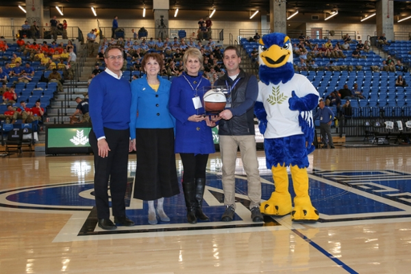Northeast Georgia Health System was announced as the official healthcare partner of UNG Athletics. A game basketball was presented from UNG president Bonita Jacobs to NGHS President and CEO Carol Burrell during UNG's basketball homecoming Feb. 15. (l to r) Jeff Tarnowski, vice president for University Advancement at University of North Georgia; Dr. Bonita Jacobs, president of UNG; Carol Burrell, president and CEO of Northeast Georgia Health System; Dr. John Vachtsevanos, team physician and orthopedic surgeon with Specialty Orthopedics; Nigel the Nighthawk.