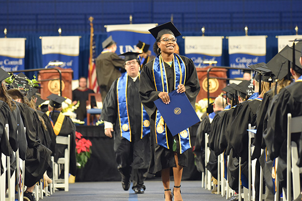 Graduates walk in the fall 2019 commencement. UNG moved up to 15th among public regional universities in the South on the U.S. News & World Report 2021 Best Colleges list.